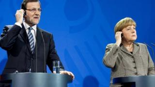 German Chancellor Angela Merkel (r) and Spanish Prime Minister Mariano Rajoy