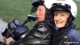 Older couple on bike