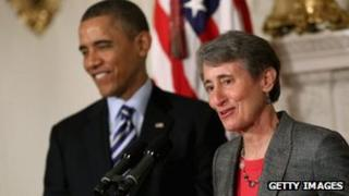 US President Barack Obama (background) with Sally Jewell at the White House 6 February 2012