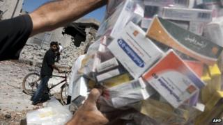 Bag of medicines salvaged from bombed pharmacy in the Bustan Pasha neighbourhood of Syria's northern city of Aleppo on 23 August 2012.