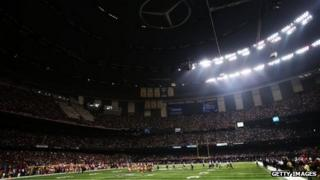 A partial power outage during the third quarter causes a 34-minute delay in the game during Super Bowl XLVII 3 February 2013