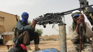 Islamist fighters man a position near Gao airport, file pic from August 2012