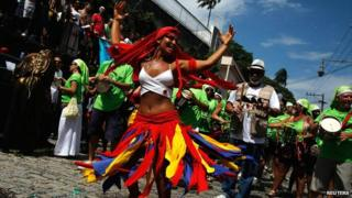 A reveller dances during the annual block party known as Carmelitas in Rio de Janeiro, 8 February 2013