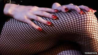 Fishnets and red nails