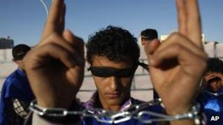A Yemeni protester with covered eyes and shackled hands in Sanaa. Photo: 11 February 2013