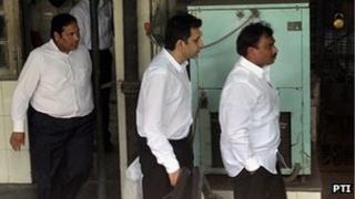 Sanjay Chandra (middle)