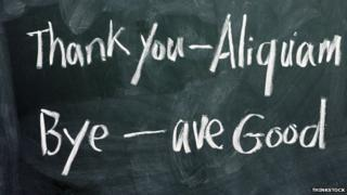 Latin for thank you and bye written on a blackboard