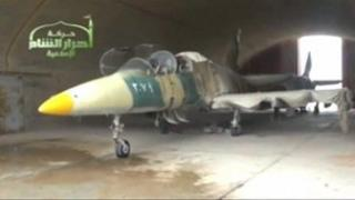 Still from Ugarit News video, purported to show fighter plane at al-Jarrah air base seized by rebels (12/02/13)