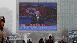 On a large television screen in front of Pyongyang's railway station, a North Korean state television broadcaster announces the news that North Korea conducted a nuclear test on Tuesday