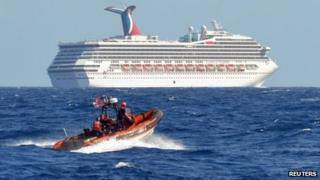 A small boat from the US Coast Guard Cutter Vigorous patrols near the cruise ship Carnival Triumph in the Gulf of Mexico, 11 February 2013