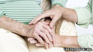 Elderly woman with her carer