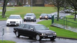 Mourners arriving for the funeral