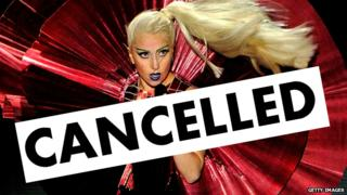 Lady Gaga performing with the word cancelled superimposed.