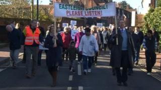 Protesters marching to oppose the housing plan