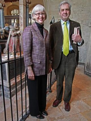 Dr Lesley Peterson and Lord Falkland, 15th Viscount Falkland in front of the effigy of Elizabeth Tanfield (Cary) on her parents' tomb in Burford Church