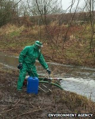 Environment Agency officer dealing with a pollution incident in Newport, Shropshire