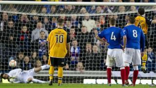 Rangers goalkeeper Neil Alexander saves a penalty from Annan's Scott Chaplain