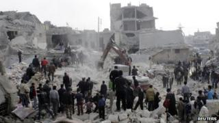 Peopel search for survivors after a rocket strike on Aleppo. Photo: 19 February 2013