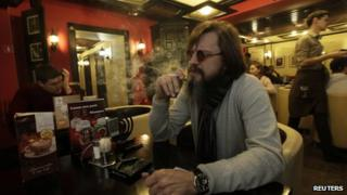 A man smoking a cigarette in a cafe in Siberia