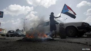 Follower of separatist Southern Movement holds a flag of former South Yemen in Aden. 26 Feb 2013