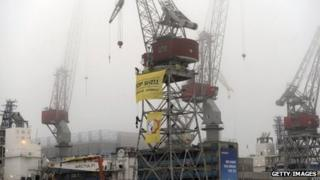 Greenpeace activists protest at the port of Helsinki against Shell's activities in the Arctic