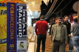 Barca and Real Madrid banners on Kurdish street