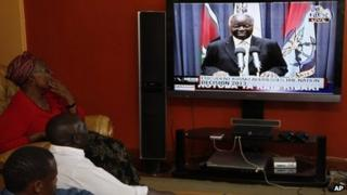 Kenyans watch as the President of the Republic of Kenya, Mwai Kibaki addresses the nation, Friday, March 1, 2013 in Nairobi, Kenya, ahead of the Monday March 4, 2013 General Election