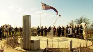 Enthusiasts, reenactors and local officials attended the ceremony