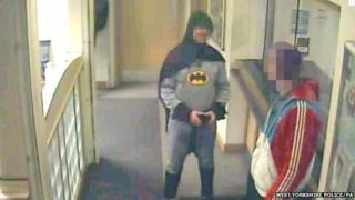 A man dressed as Batman in the police station