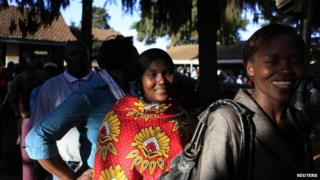 People queue at a polling station in the Nairobi district of Kibera