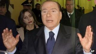 Silvio Berlusconi leaves a Milan court on 1 March 2013