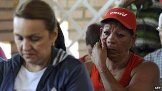 Supporters of Venezuelan President Hugo Chavez cry during prayers at the chapel inside the Military Hospital in Caracas