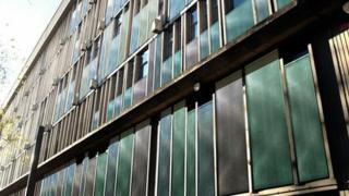 London-based artist Antoni Malinowski has enhanced the building's concrete fins by using coloured panels.
