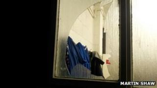 The broken window at the Woking dressing room