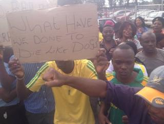 """""""What have we done to die like dogs?"""" - demonstrators outside Benoni magistrate's court, South Africa, 8 March"""
