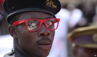 A man wearing a President Robert Mugabe designer label beret - 21 January 2013