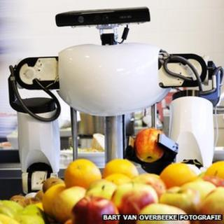 Robot holding apple