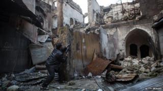 A Syrian rebel prepares for battle in Aleppo