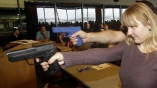 Joanna Baginska a fourth-grade teacher from Odyssey Charted School, in American Fork, Utah, aims a gun 27 December 2012,