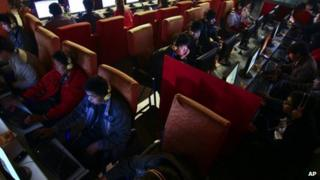 "People use computers at an Internet cafe in Fuyang, in central China""s Anhui province"