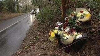 Flowers marking site of car crash