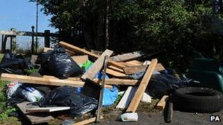 """Rubbish dumped by a sign that reads """"No Dumping"""""""