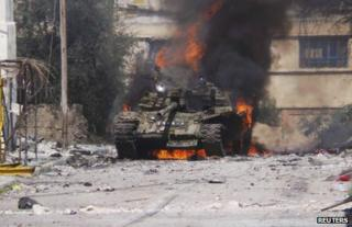 A tank burns in Daraa, Syria, 9 March