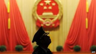 A member of the Chinese military band looks on before the closing session of the National People's Congress at the Great Hall of the People in Beijing, 17 March 2013