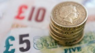 Notes and coins in British pound sterling