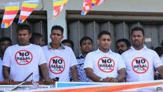 Sri Lanka's hardline Buddhist group Bodhu Bala Sena members wear T- shirts urging boycott of consumer goods with Halal certification during a protest rally in Maharagama on the outskirts of Colombo, Sri Lanka, Sunday, Feb. 17, 2013