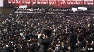 Satmar ultra-Orthodox Jewish men congregate in Brooklyn in 2011