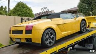 An undated handout photo received from the Australian Federal Police on 23 March 2013 shows a Lamborghini being confiscated in Australia