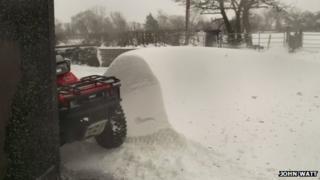 Snow drift beside quad bike
