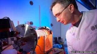 Dr Toby Jenkins using equipment to coat the dressing with nanocapsules